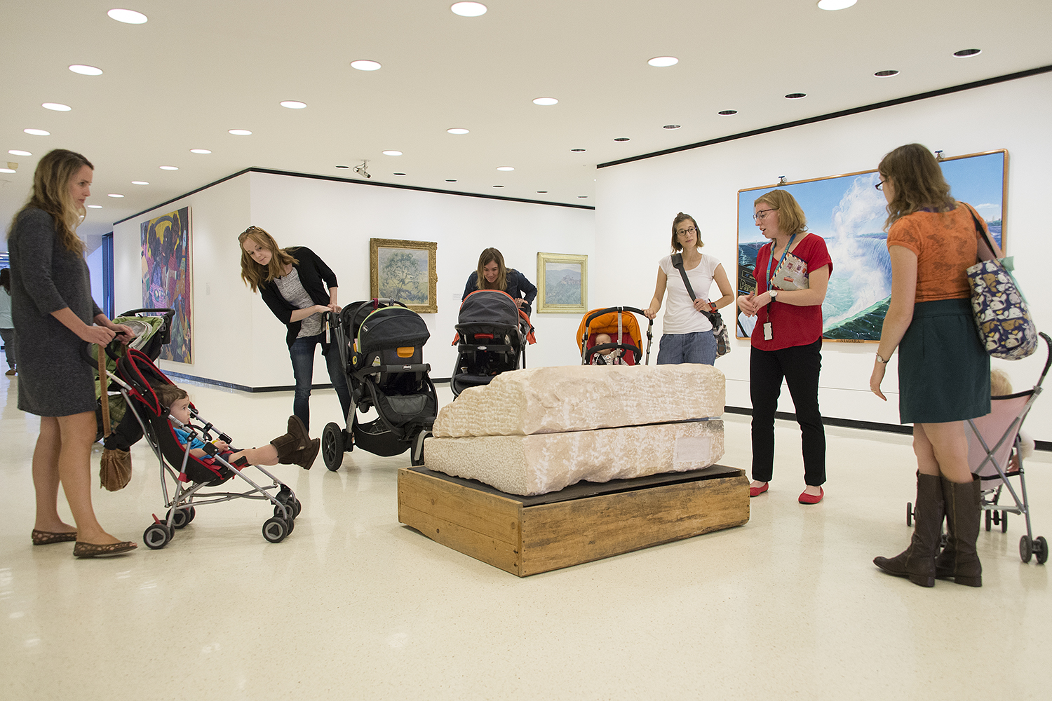 Women push strollers through the Albright-Knox Art Gallery