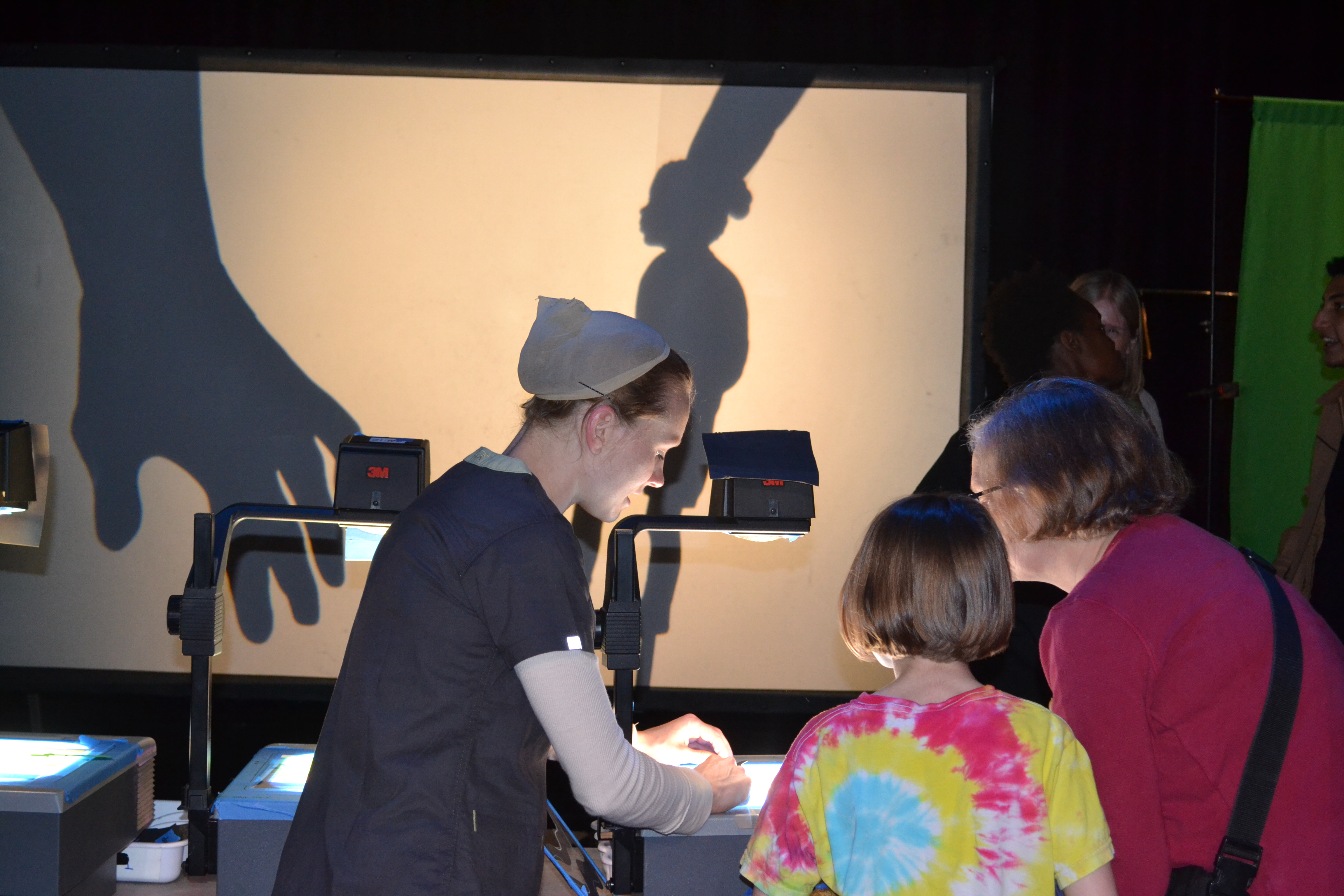 Visitors work with projectors at the Lake Placid Center for the Arts