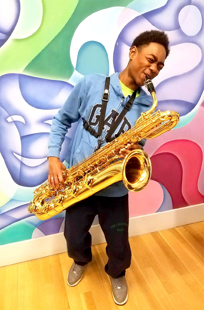 Mind-Builders Kid Plays Saxophone