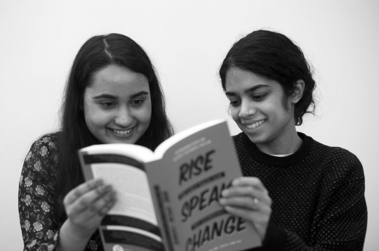 Mentee/Mentor pair looking at the 2017 Girls Write Now anthology, Rise Speak Change. Courtesy of Girls Write Now, New York, NY.