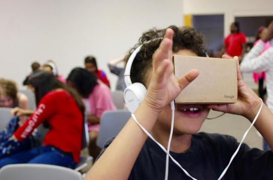 Photo of child using Google Cardboard by Spark Media Project/The Art Effect, Poughkeepsie, NY.